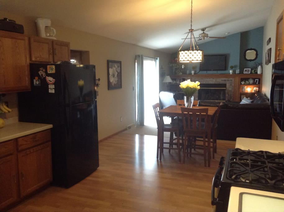 Large open eat in kitchen and family room with H.D T.V. And fireplace.