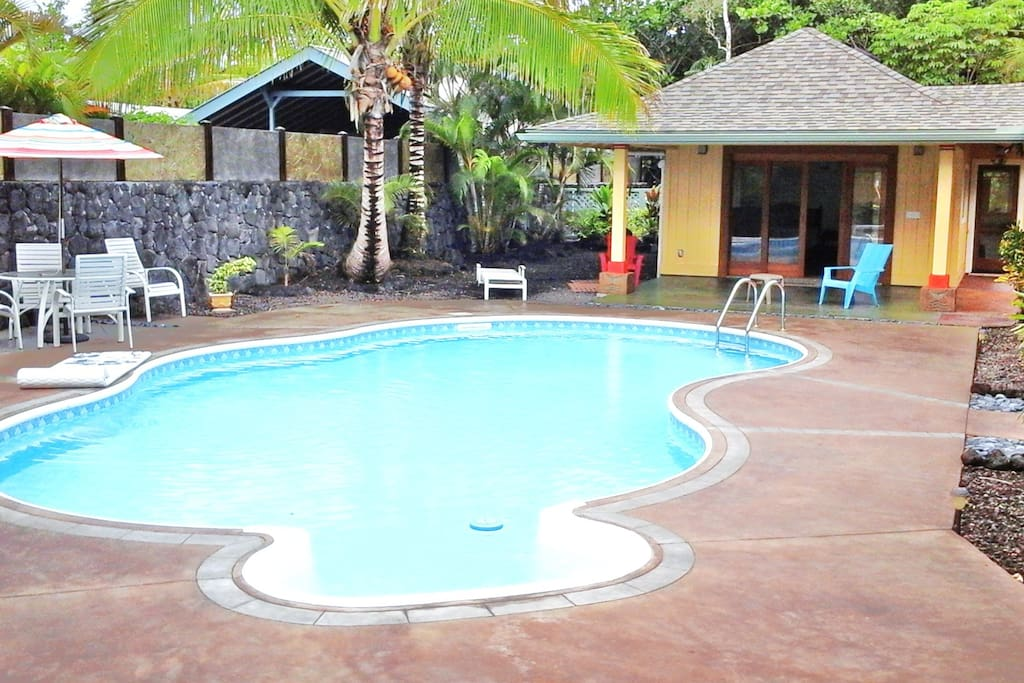 View of pool and ajoining cabana