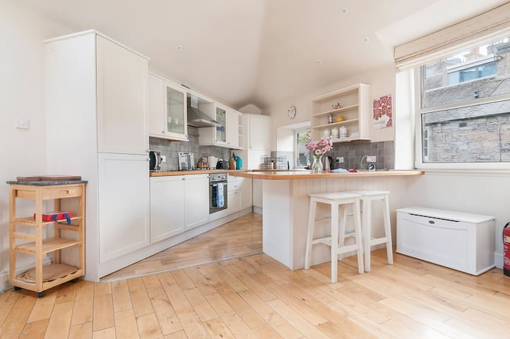 Well equipped kitchen with dishwasher, fridge freezer, fan oven, washing machine and tumble dryer