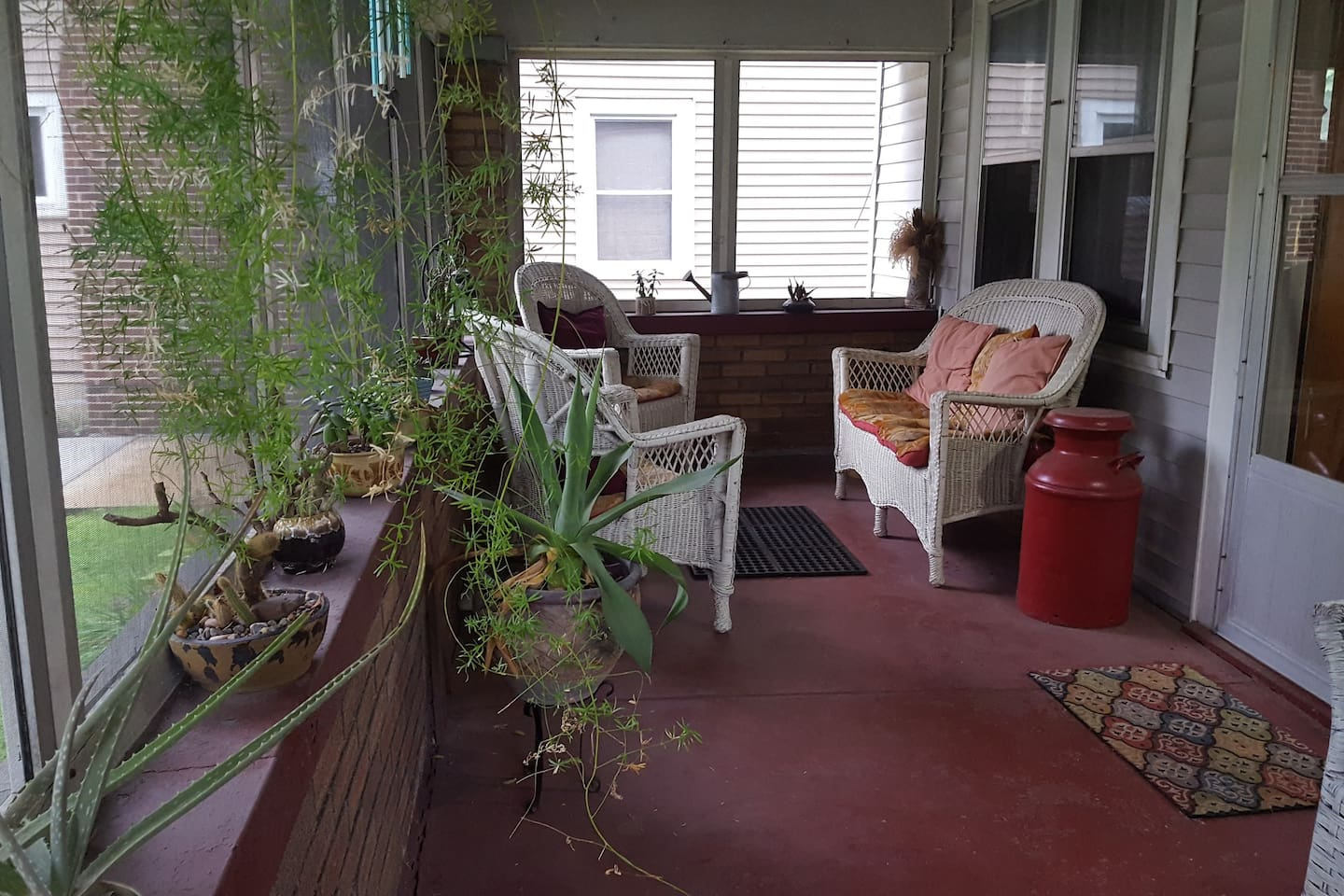 Welcome to my urban cottage! The front porch is perfect for quiet time or socializing.