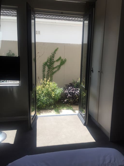 Let the sun shine in by opening the doors to a small outside space
