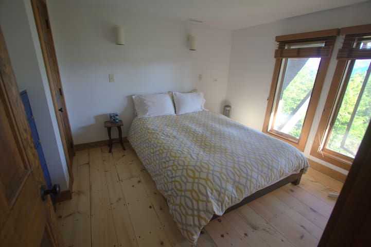 Lower level bedroom with queen bed