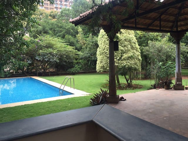 Villa, garden, and pool, Whitefield