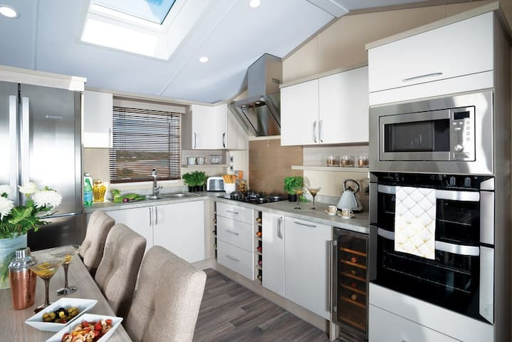 Kitchen  Images may have been selected from the manufactures image galleries. These are not the views from the windows.