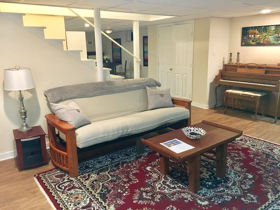 The futon converts to a full size bed, with easy instructions in the welcome guide. There are linens, blankets, and pillows for the futon in the linen closet area of the bedroom.