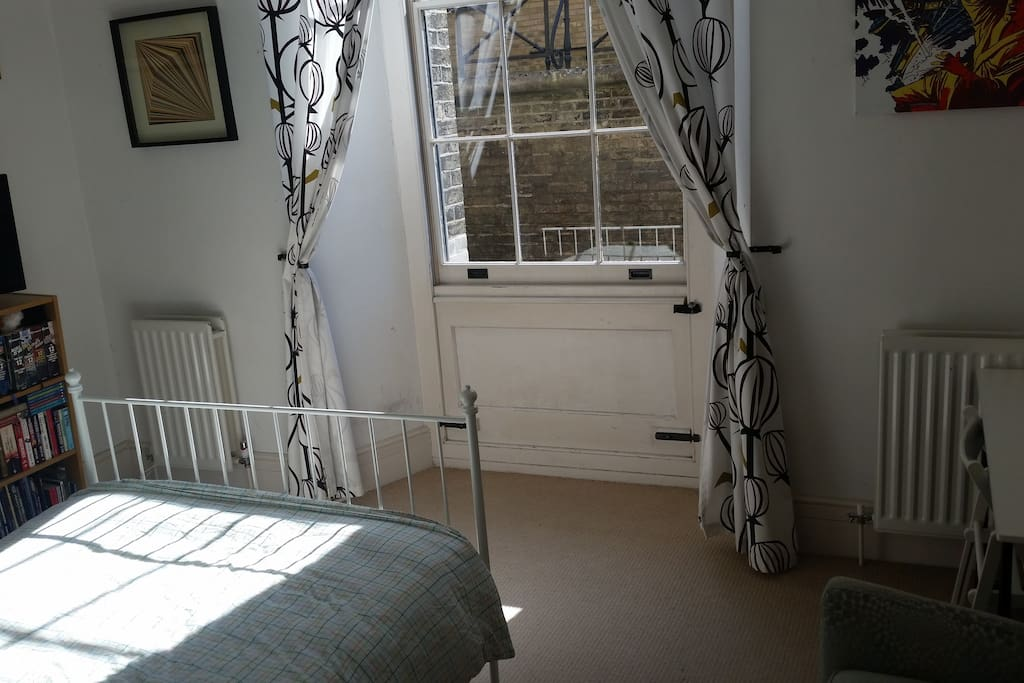 View of the bedroom with door to terrace