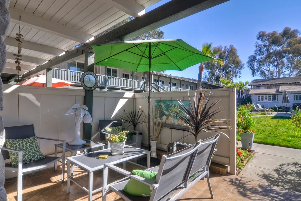 Relax on your own private front patio after a nice day at the beach