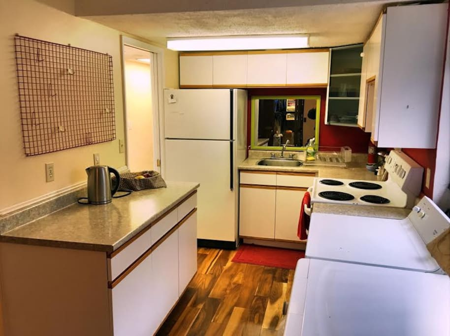 Fully equipped kitchen with laundry facilities.