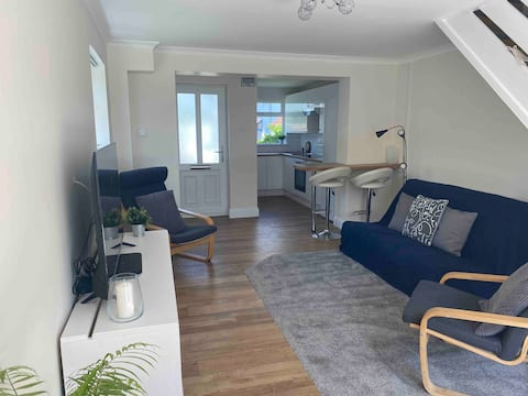Modern 1 bedroom home with parking and a garden