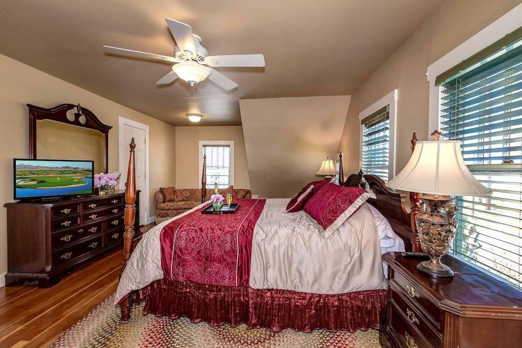 Master bedroom with flat screen TV and king bed