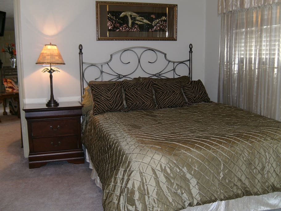 Comfy Queen size bed with bedroom balcony.