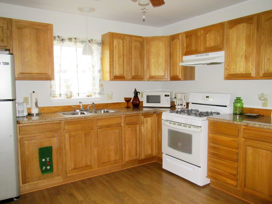 Fully stocked kitchen with all cookware, dishware, utensils and appliances; light cooking supplies, coffee, tea and more.