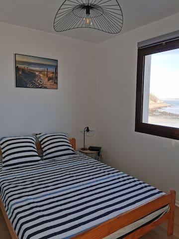 Chambre lit double avec vu mer