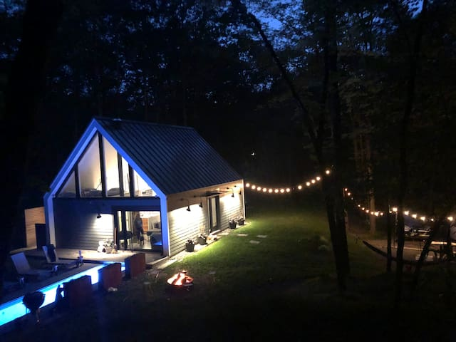 Modern Upstate NY cabin + hot pool in the woods.