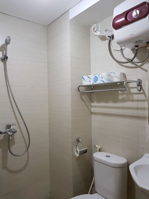 Bathroom with water heater and toiletries