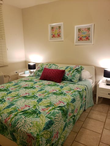 Second bedroom with queen size bed and AC.  *Bedding designs may change and be updated.