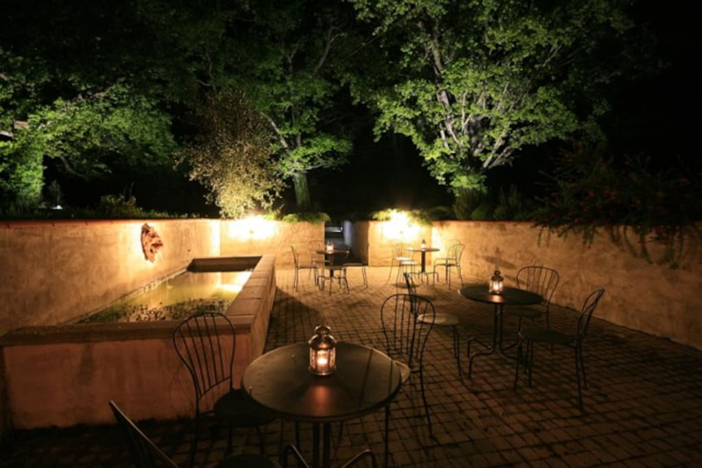 Courtyard area in garden with seating and lighting
