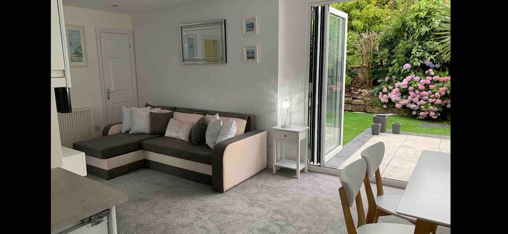 Enjoy the open plan living space with bi-folding doors to the garden area which faces south & a real gem of a sun trap.