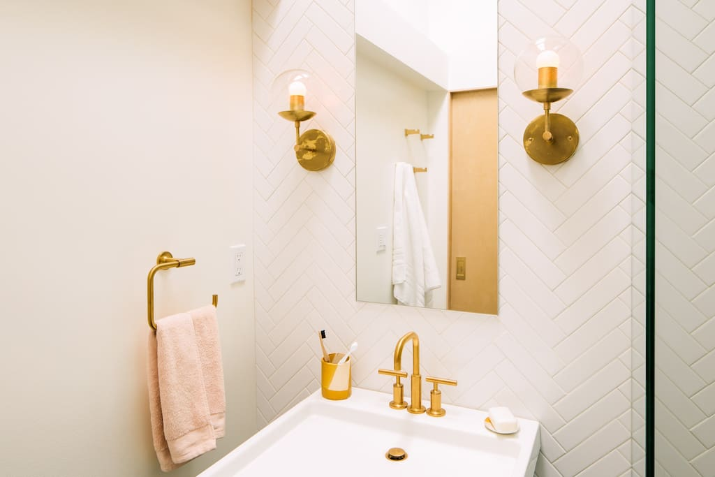 huge & bright shower with dimmable lighting and a cozy tile floor.