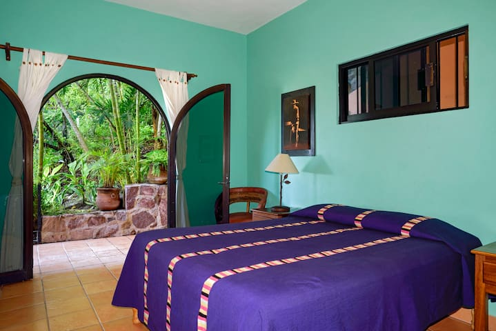 Two queens are available for this garden room.  Or put the extra bed up on the open air palapa level...