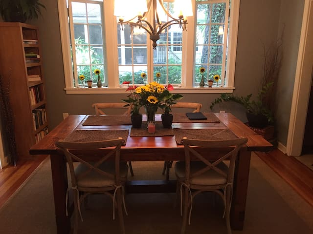 The dining room features a handcrafted table and plenty of space to enjoy your meals.