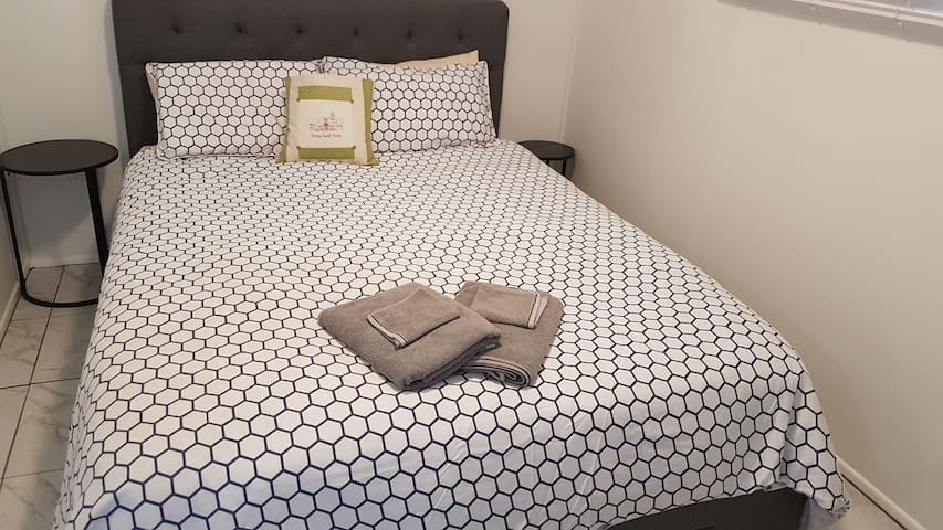 Ready for a comfortable nights sleep, a beautiful queen bed with soft head board. Great for those that enjoy to read in bed. This room has been repainted and tiled and flows through to the living room.