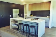 Kitchen with butler pantry and separate wine fridge.