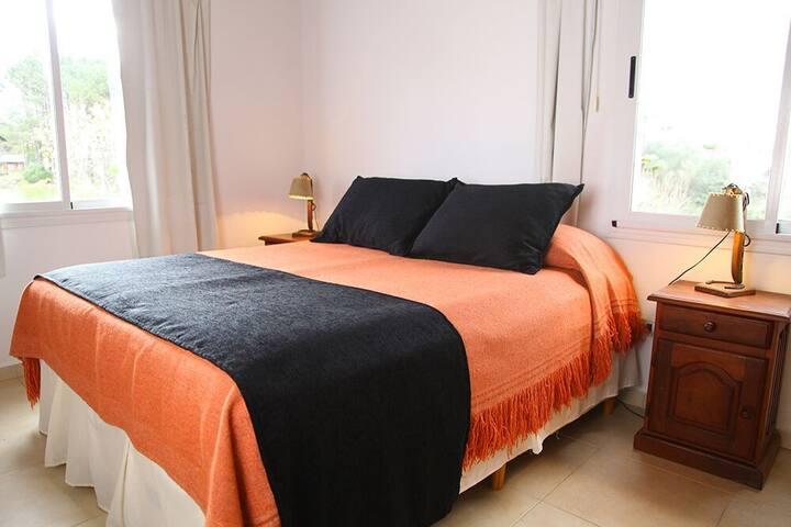 Dormitorio cama queen size