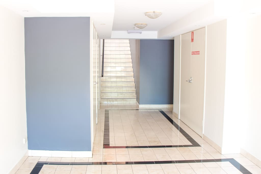 Foyer: one flight of stairs leads you to the pathway to studio #2