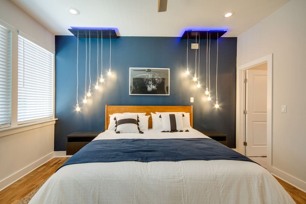 King Sized bed in Master with Custom Cascade Lighting Specifically designed for this space!