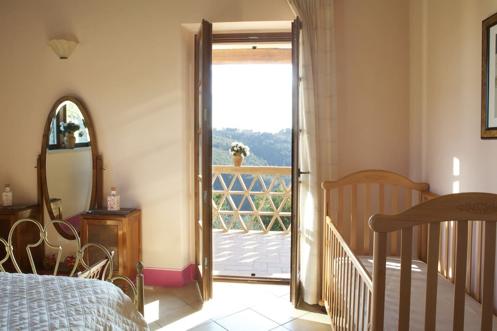 romantic double bedroom with direct access to the private terrace with glorious view on the valleys and the hills