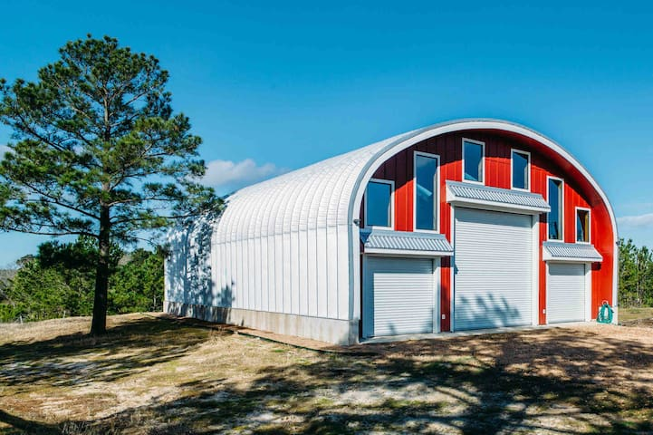 Steelwaters. Contemporary Quonset on forty acres.