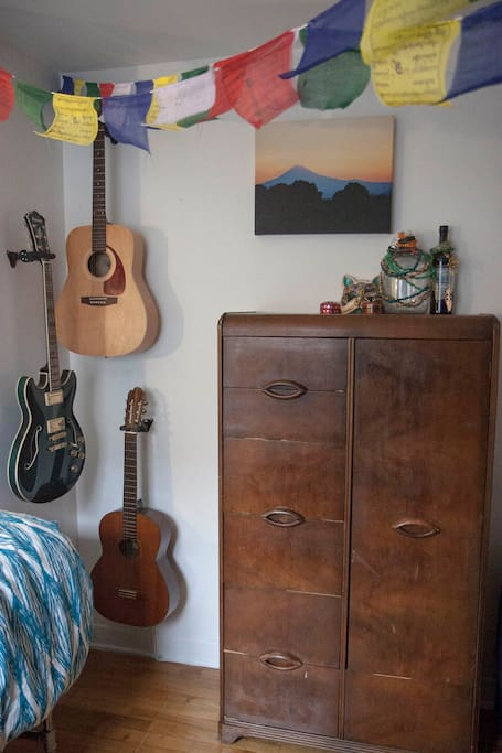 Artdeco wardrobe with hanging space next to my guitar collection.