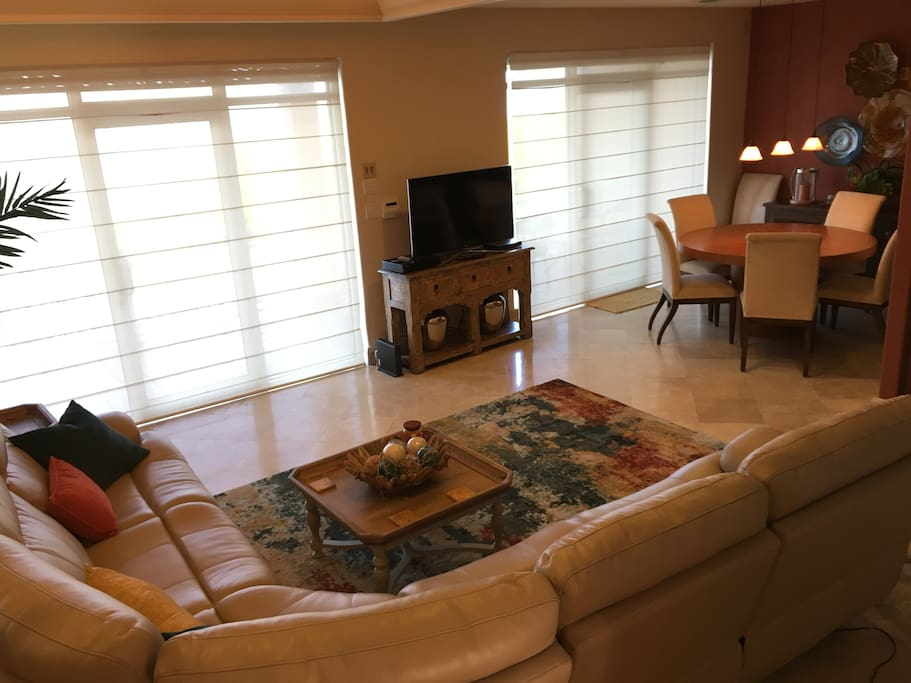 Living Room, Dining Room, Satellite TV, closed shutters, the kitchen is located to the right