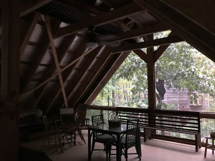 Interior view, (if you can zoom in our house is in background-30 yds away which ensures your privacy). Sleeping Porch space is 28 x 28 w/sleeping loft, hammock, sitting areas, dining area and outdoor deck overlooking the creek.