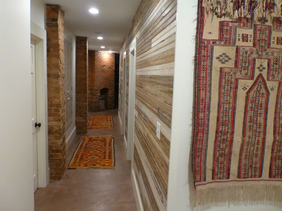 The hallway, lined with brick and repurposed bead board.
