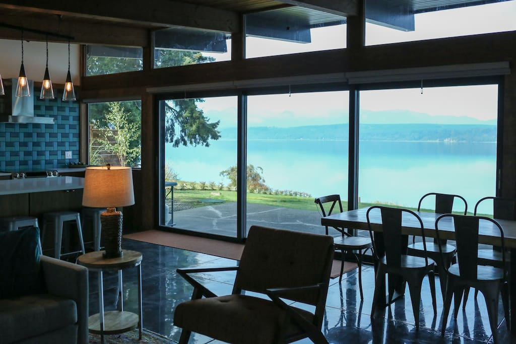 Triple sliding doors stack to open house to the outdoors.