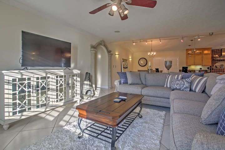 Stylish decor and a flat-screen cable TV make the living room warm and inviting.