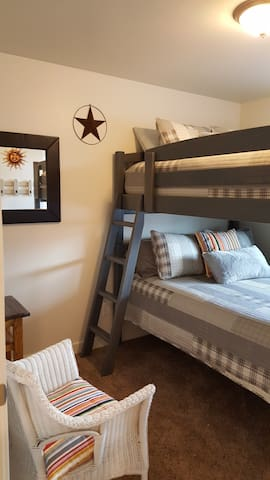 Adult size, double queen bunks! We fit large families very well!