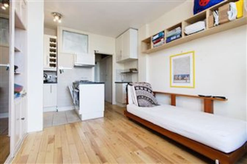 open plan kitchen with washer/dryer, fridge/freezer/dishwasher, electric oven & hob.