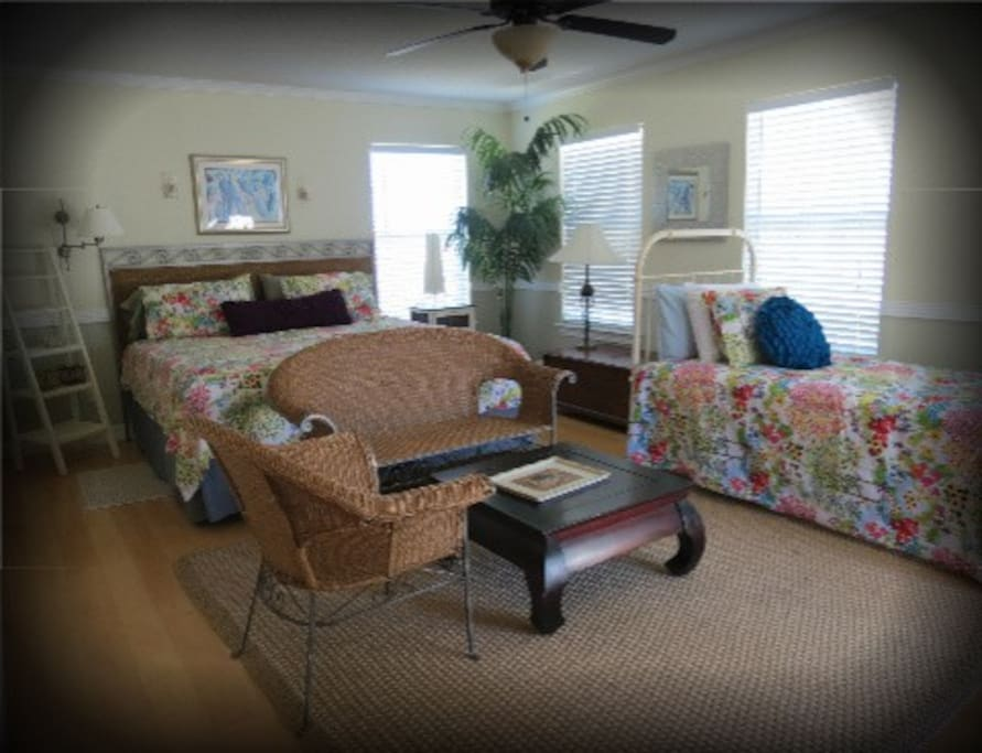 Living area on second level King Bed and Twin bed with Adjoining Deck and Master bath
