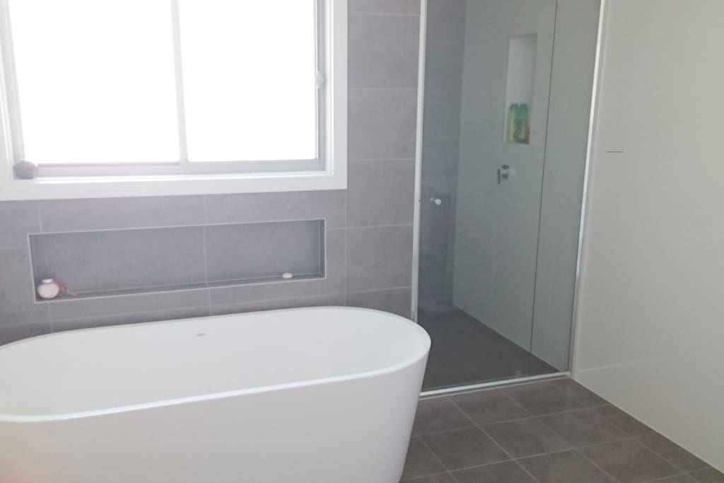 Free standing Bath to relax in and large shower. Shared if we have other guests. There is another shower and toilet downstairs in the laundry