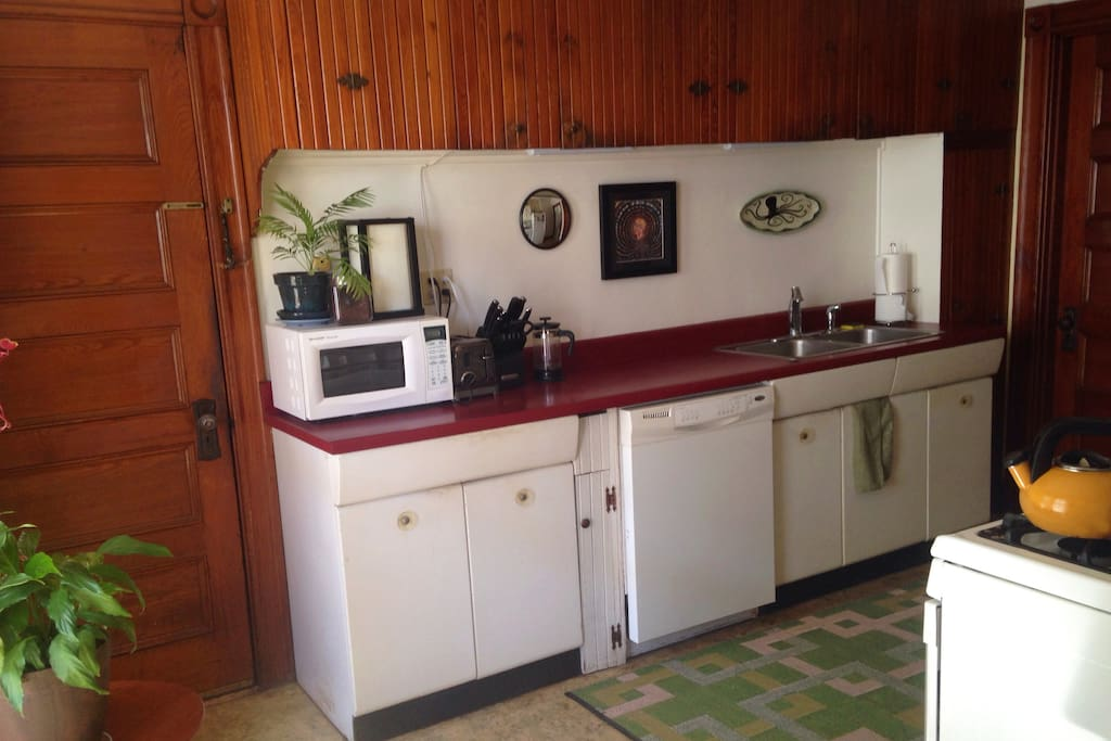 Large eat in kitchen, facing yard, with plenty of light, dishwasher, full sized gas stove, counter and cupboard and refrigerator space to share