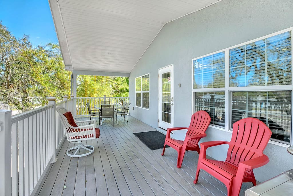 Pull up a chair and enjoy tree-lined balcony views.