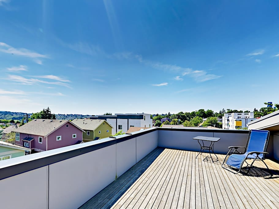 A private rooftop deck offers expansive Seattle views.