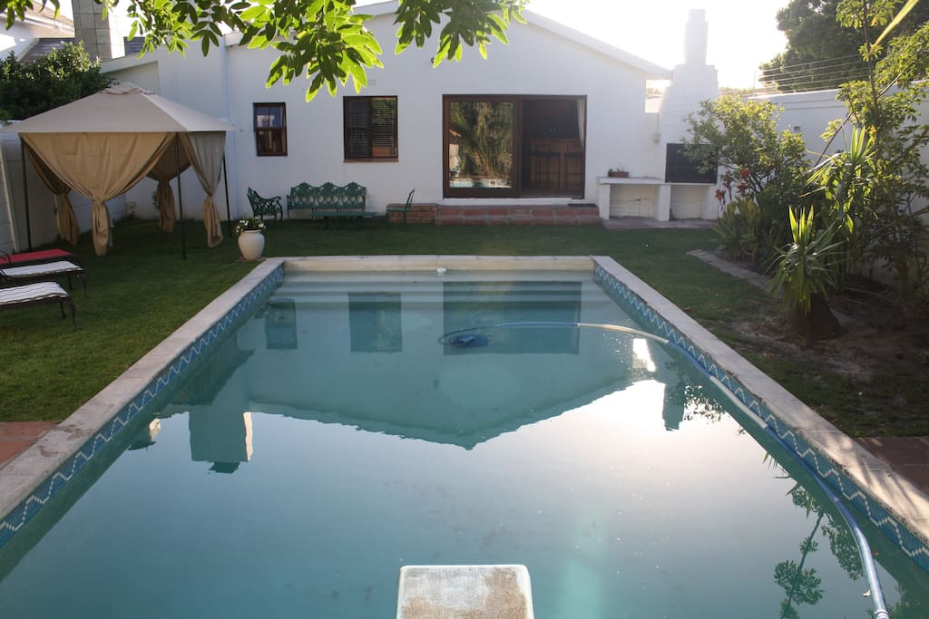Outside area - deep pool diving board, chill spaces and barbecue