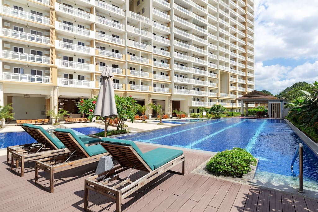 """A spectacular and refreshing full view of Tropical Oasis' kiddie pools and lap pool for adults- a beautiful sight of peace and tranquility...away from """"IT"""" all!"""