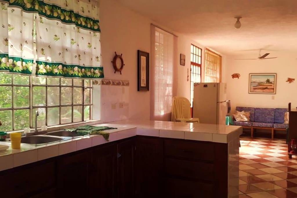 Cocina, comedor y sala