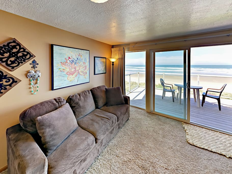 Sliding glass doors open to the spacious balcony with a 2-person table.