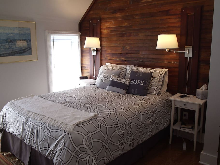 The accent wall in the guest bedroom was the flooring before renovation of the second floor.